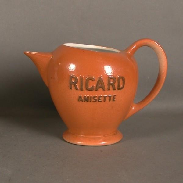 Pottery pitcher. Ricard....