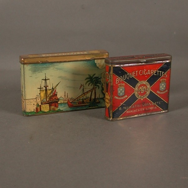 Two advertising tins....