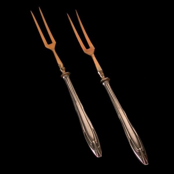 Dos tenedores de carne...