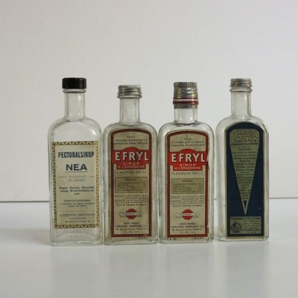 Four apothecary bottles....