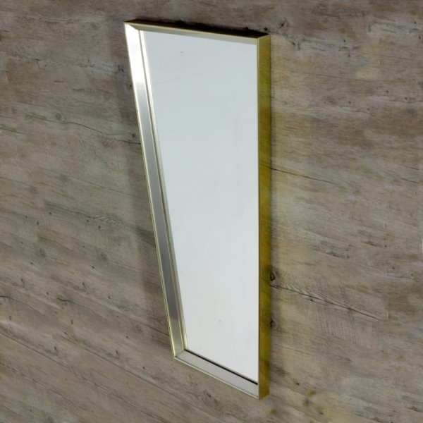 Wall mirror with metal...