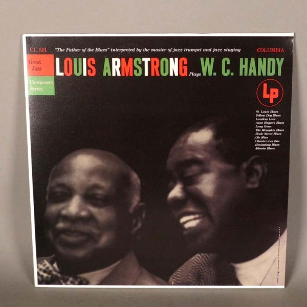 Louis Armstrong - plays...