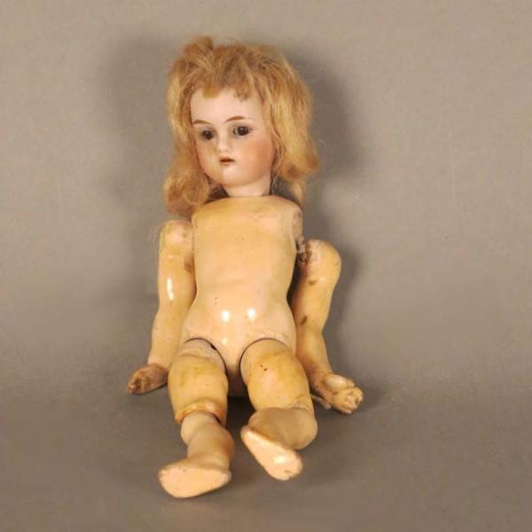 Muñeca con cabeza de...
