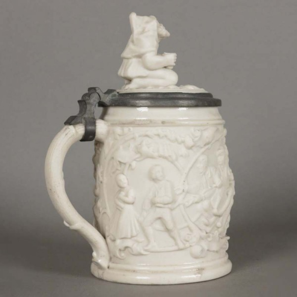 Porcelain beer mug with...