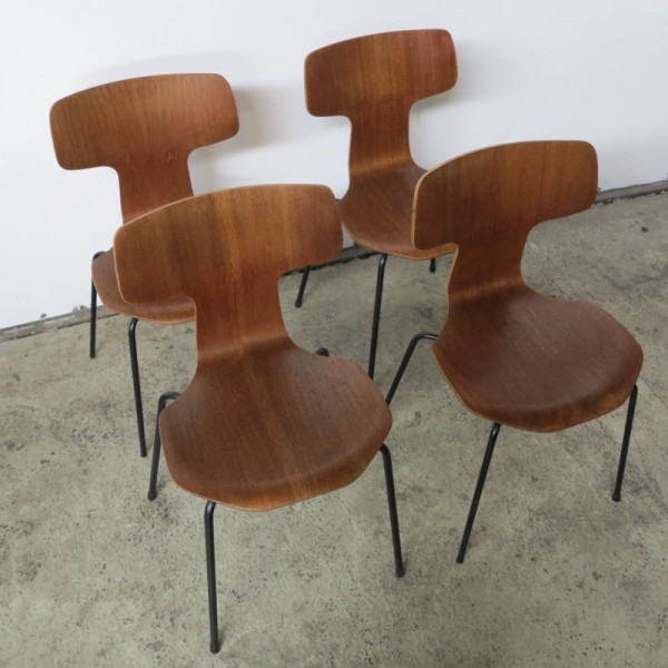 Four Teak Hammer Chairs by...