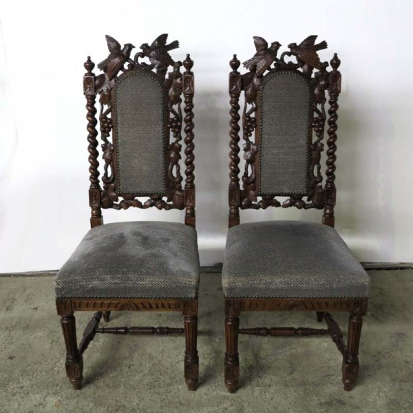 Two chairs with carved...