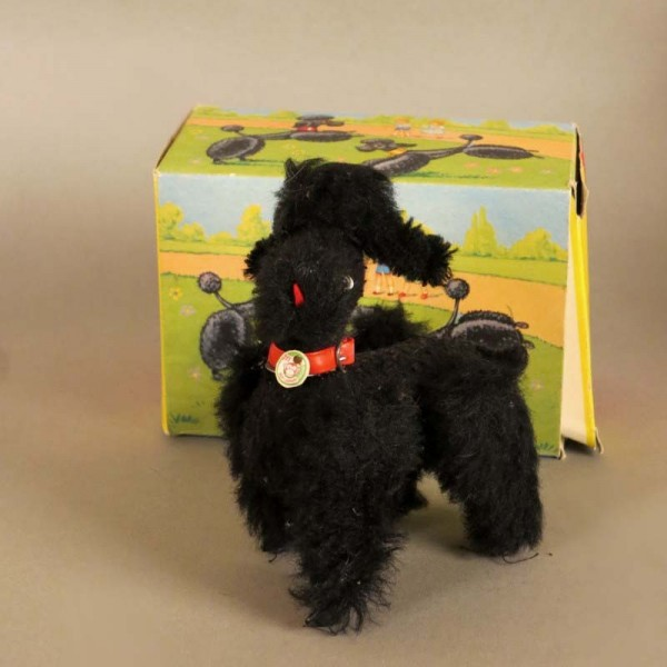 Mechanical poodle with box...