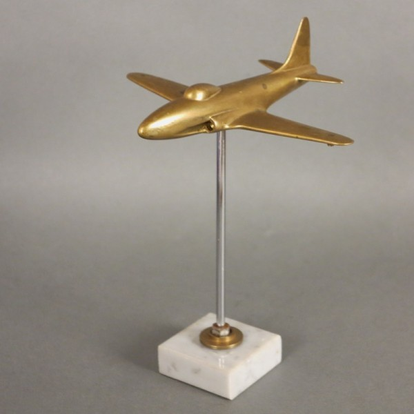 Brass aircraft on marble...