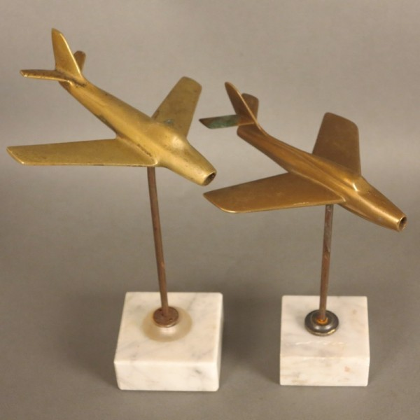 Two brass aircrafts on...