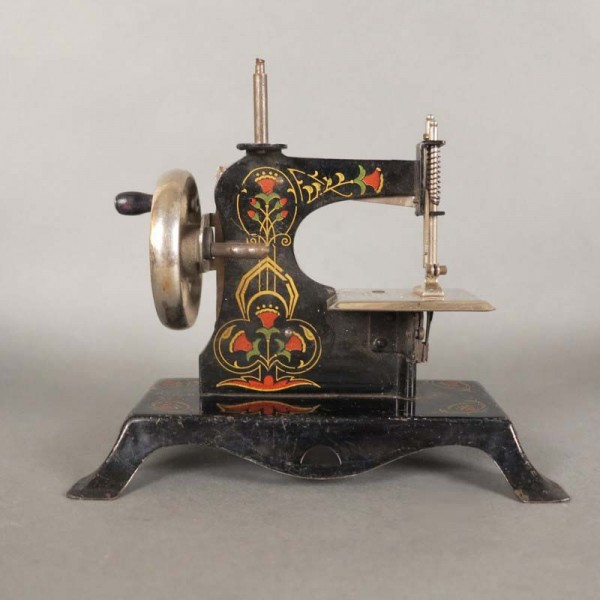 Sewing tin machine for...