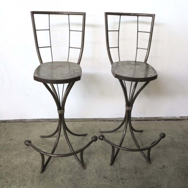 Two metal chairs in...