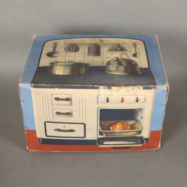 Tin toy. Doll stove in his...