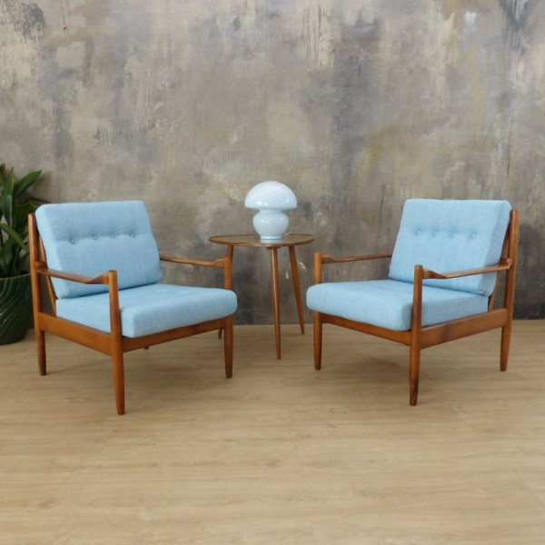 Two light blue armchairs in...