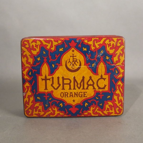 Advertising tin of Turmac...