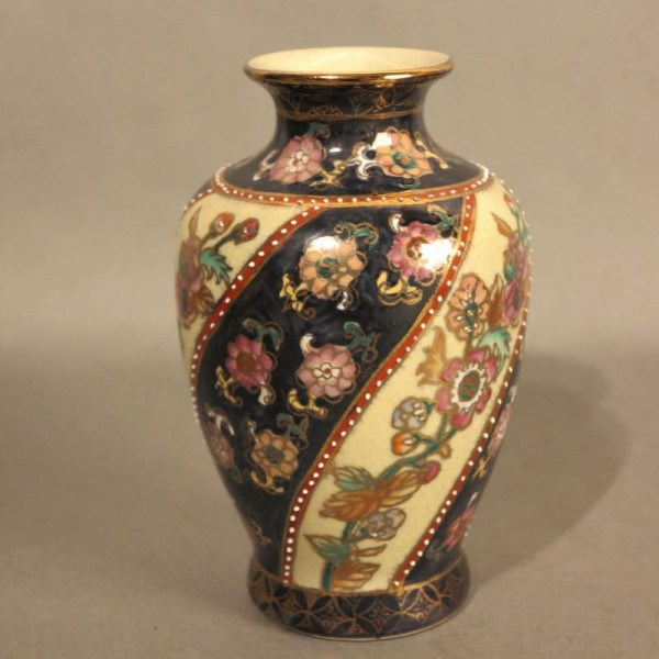 Porcelain vase with enamel...
