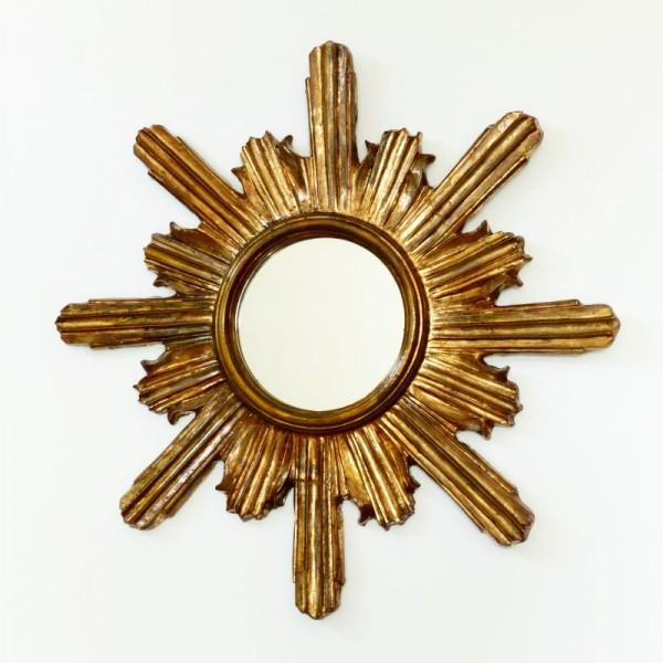 Espejo sol de madera dorado...