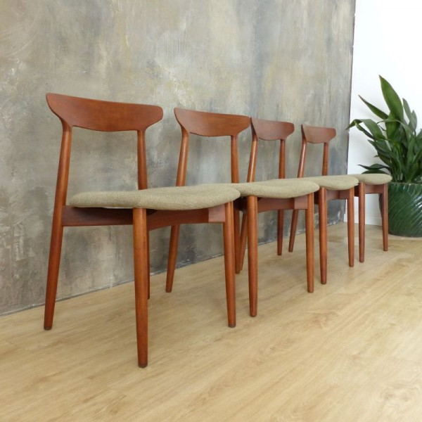 Four Teak Dining Chairs by...