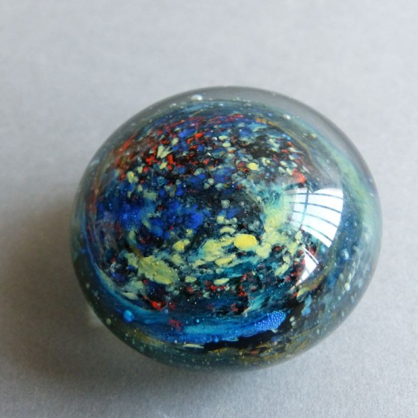 Glass paperweight by...