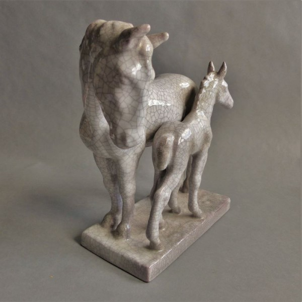 Ceramic horse group by A....