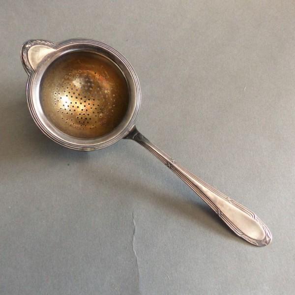 Cuchara para té plateado....