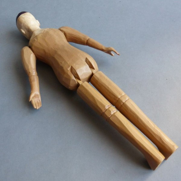 Carved jointed doll made of...