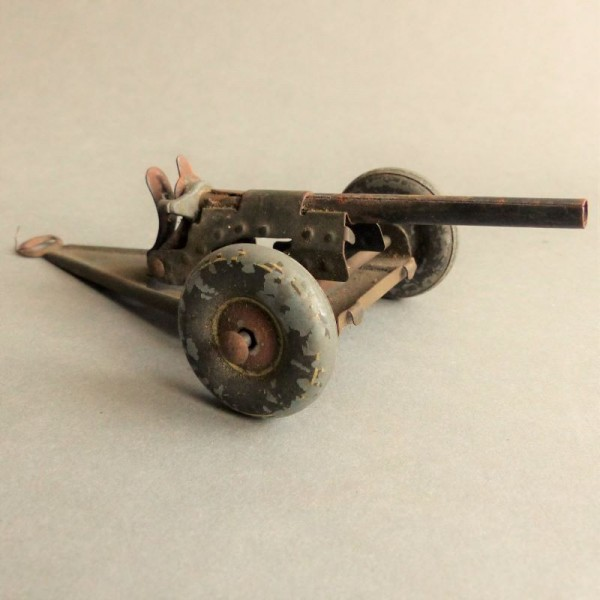 Tin toy anti-aircraft gun...