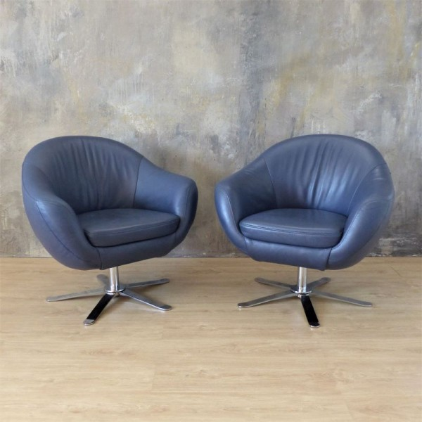 Two swivel leather...